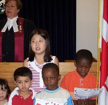 Spotlight story image pertaining to children at citizenship ceremony